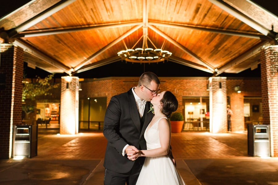 Nightime shot of groom kissing his bride for a kiss outside at the Princeton Marriott at Forrestal Wedding