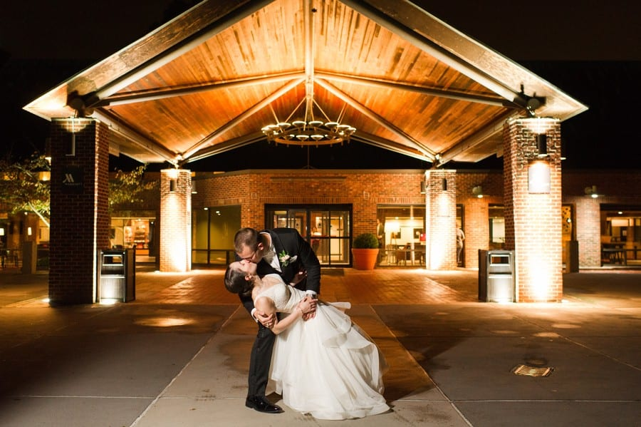 Nightime shot of groom dipping his bride for a kiss outside at the Princeton Marriott at Forrestal Wedding