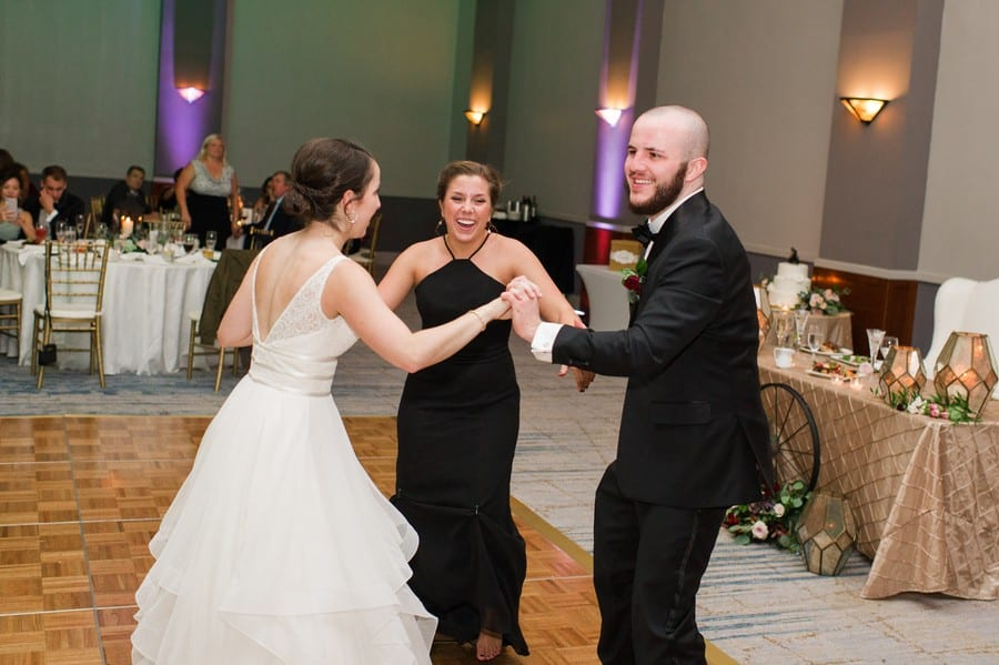 The bride shares a dance with guests during the reception