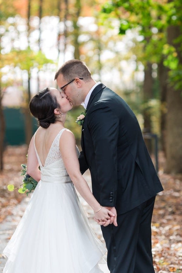 The bride and groom share a kiss during portraits