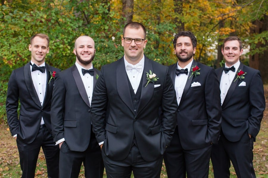The groom and his groomsmen in black tuxedos by Men's Wearhouse