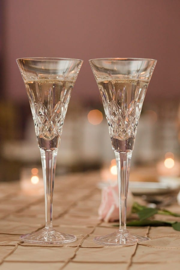 Wedding detail photo of two crystal champagne flutes at the sweetheart table