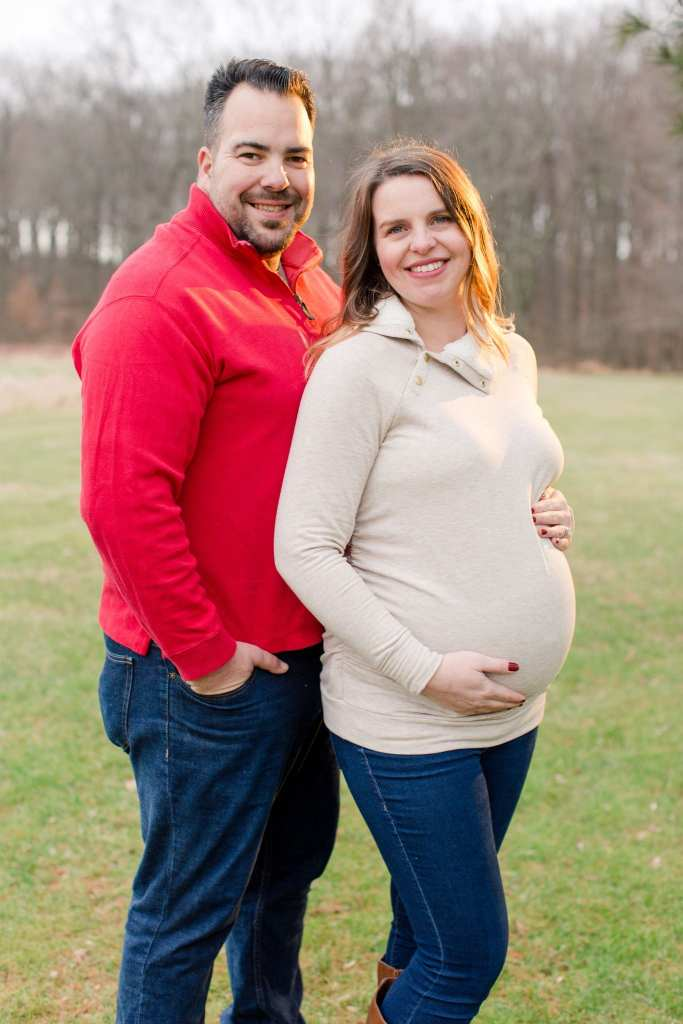 Mom and Dad to be profile shots, smiling at the camera in winter outdoor New Jersey Maternity photos