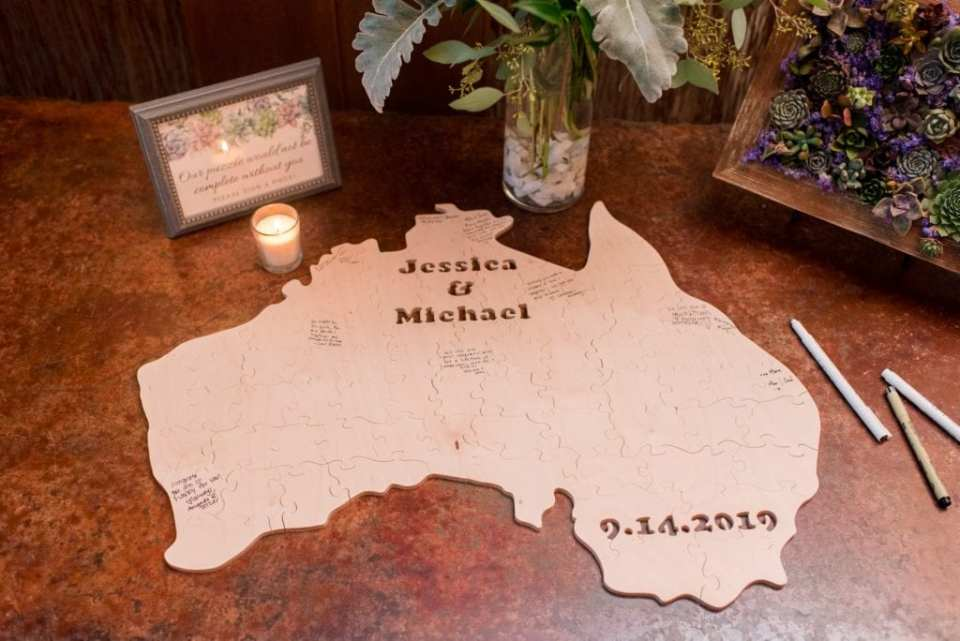 A puzzle shaped like Australia as a guest book, personalized with the bride and grooms name and date of wedding
