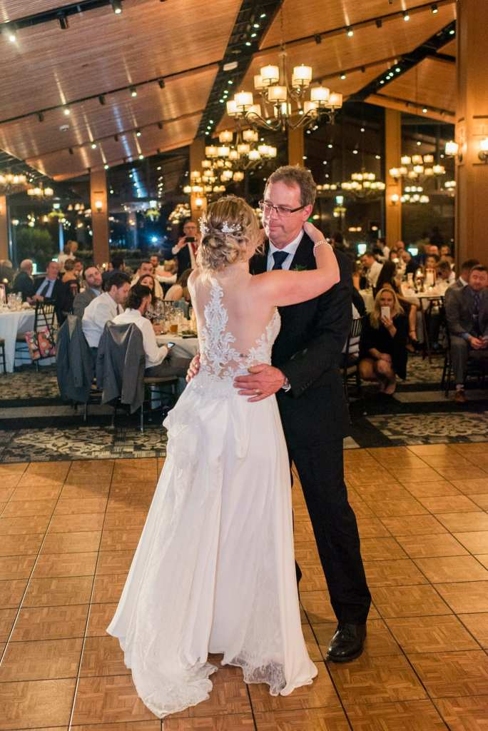 The bride in her Allure bridal gown shares a dance with her father