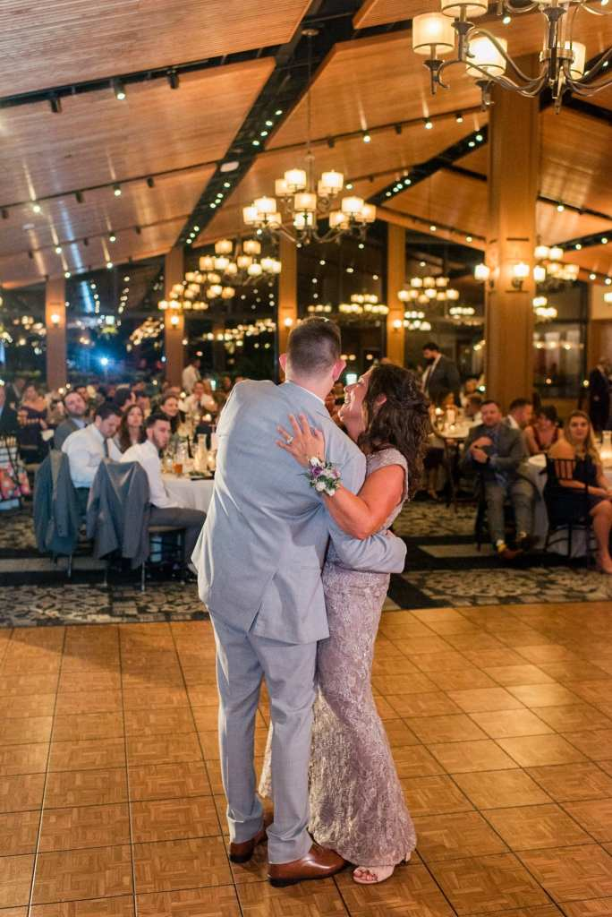 The groom and his mother share a dance in these Blue Mountain Resort wedding photos