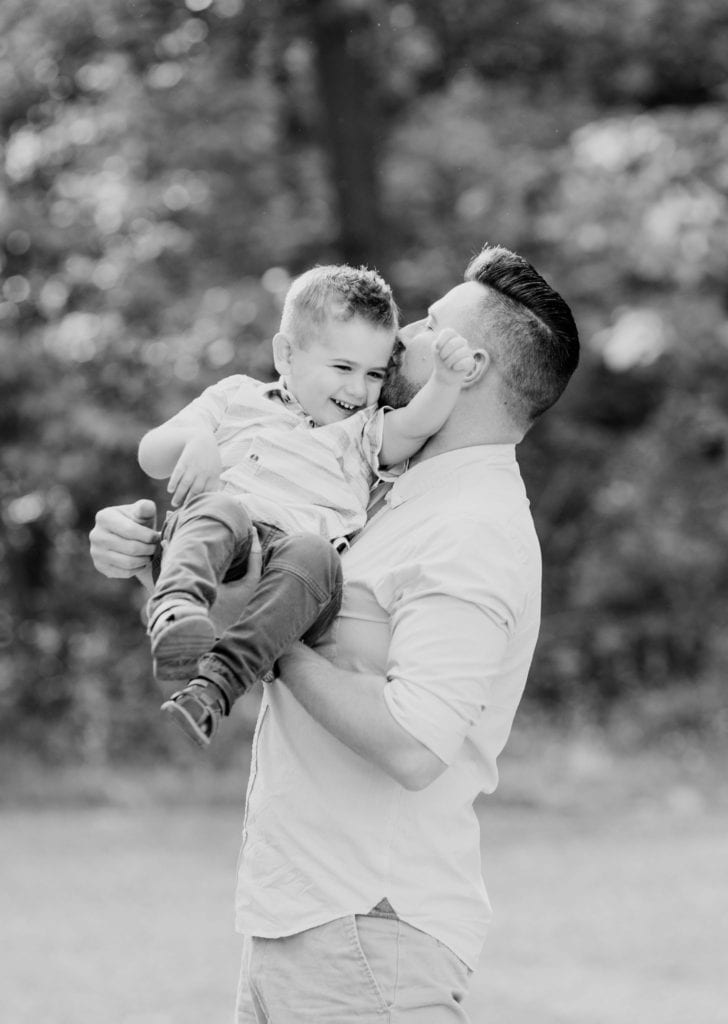 Black and white of Dad and son nuzzling one another