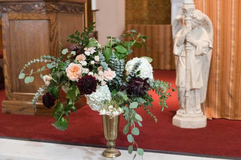 Florals by Whisper and Brook Flower Co. on display at the church