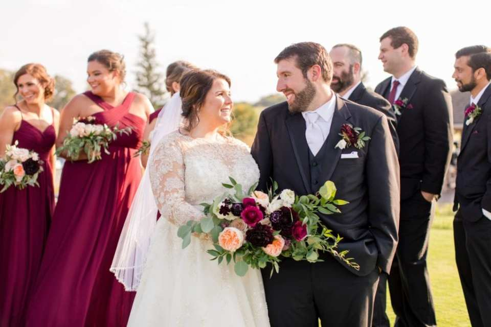 Bride and groom in front of fun wedding party photo