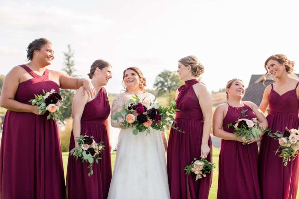Bride and her bridal party in fun photo. Bridal party in Azazie gowns