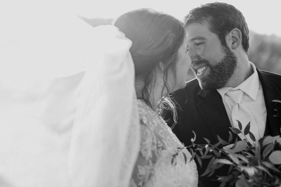 Black and white candid photo of the bride and groom