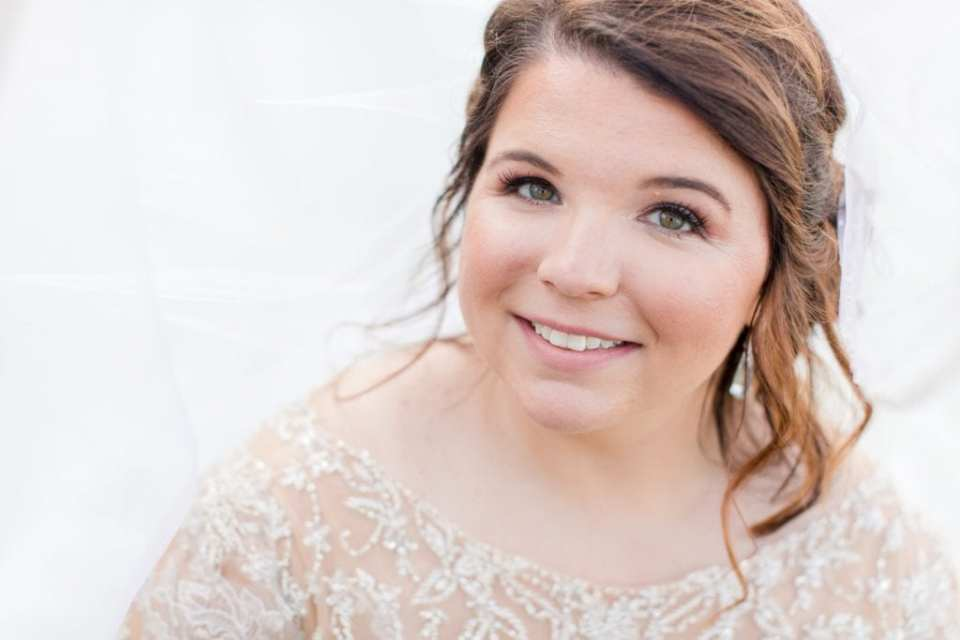 Under veil bridal portrait. Hair by Renée with Styles on Location. Makeup by Ashley Landry. Both at Ballyowen Golf Course