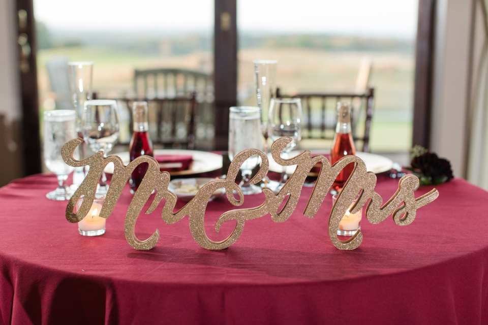 Close up of custom gold signage on the sweetheart table