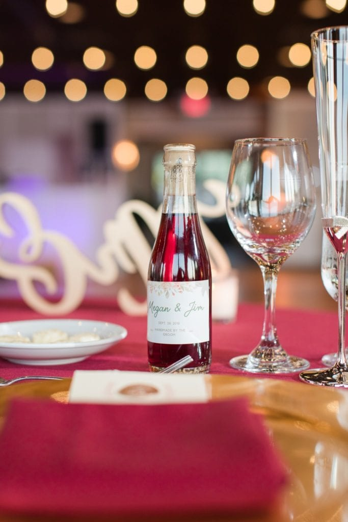 Close up photo of the custom wine wedding favor created by the bride and groom