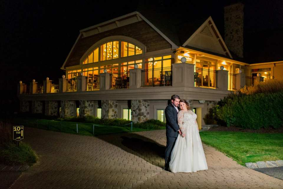 Portrait of bride and groom at night outside during their Ballyowen Golf Club wedding photos