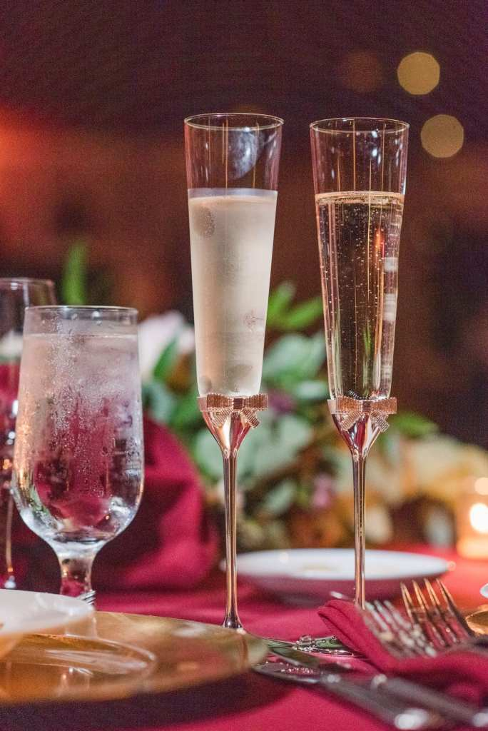 Wedding details: bride and groom's toasting flutes