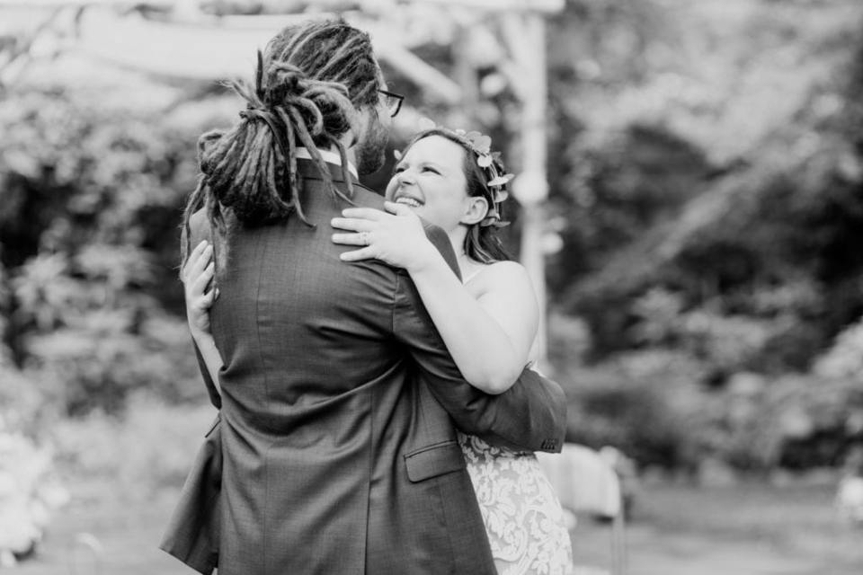 A black and white candid of the bride and groom as they share their first dance as husband and wife outdoors during the reception during their New Jersey Micro Wedding