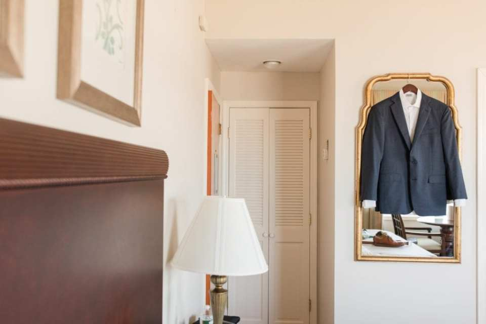 The grooms Brooks Brothers suit hanging on display