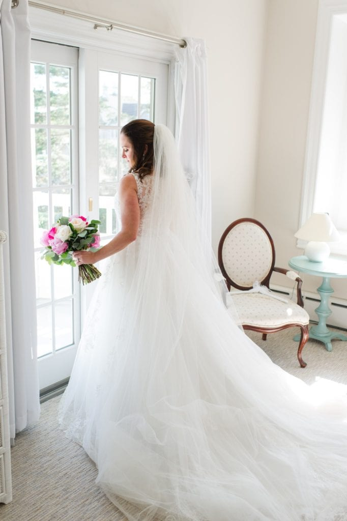 Full length bridal portrait from behind showing off the back of the Pronovias gown and cathedral length veil