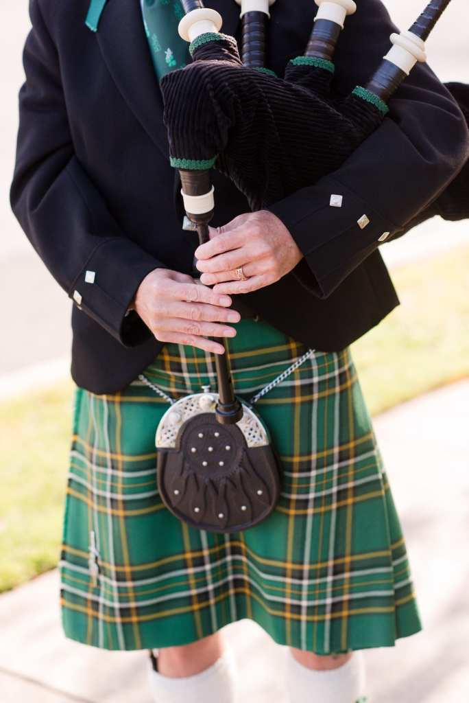 Close up of the bagpipe player