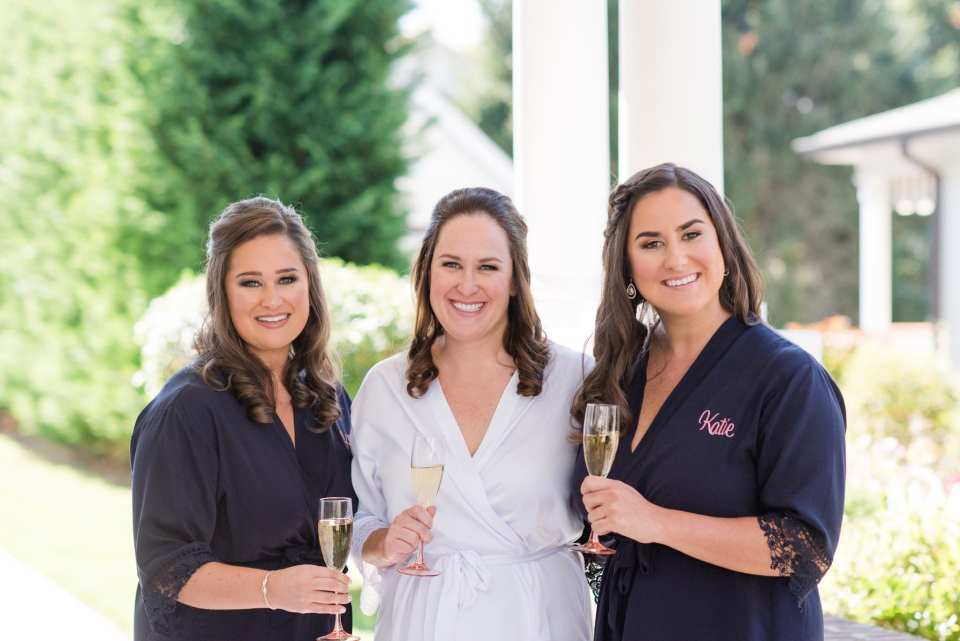 Bride and her bridal party in custom personalized robes toasting