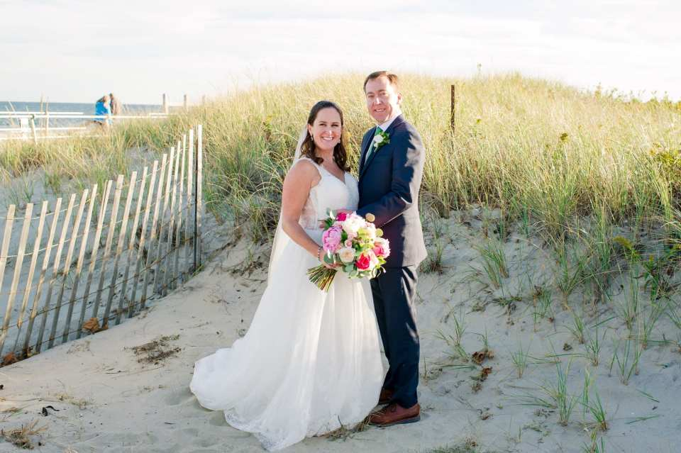 Full length portrait of the bride and groom amongst the sand dunes on Spring Lake beach