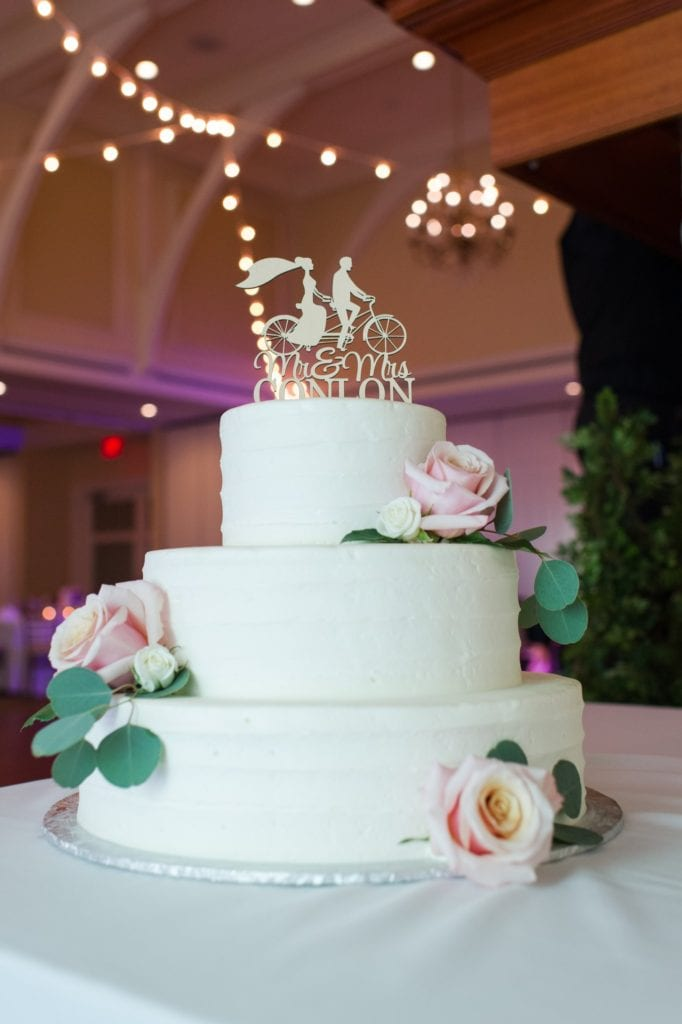 Full length photo of the three tiered light green wedding cake by the Chocolate Carousel at this Spring Lake Golf Club wedding