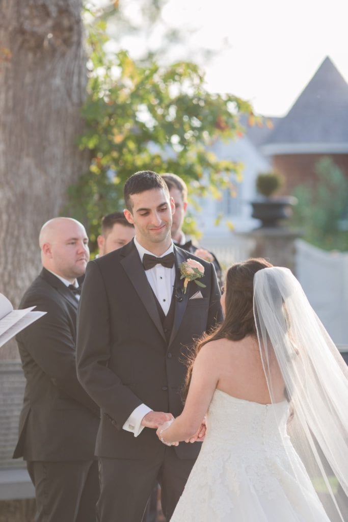 Candid photo of the groom during the wedding ceremony