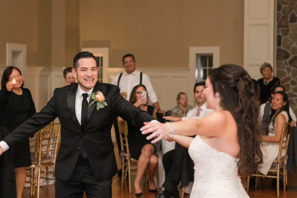 The bride shares a special dance with one of her brothers
