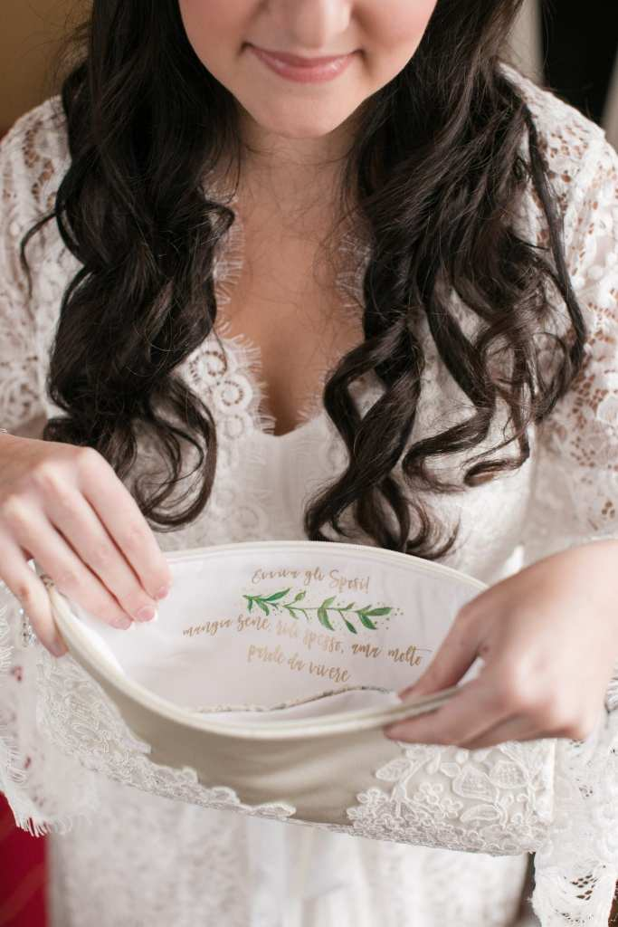 Bride holding open a custom made purse showing the special message inside