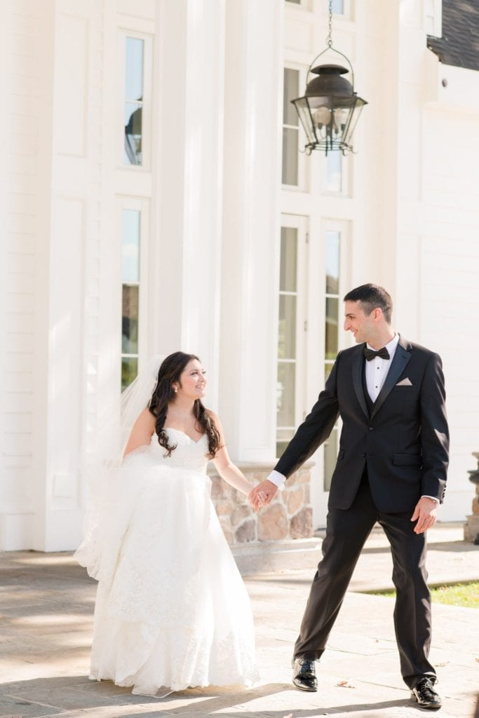 The bride and groom stroll during their first look