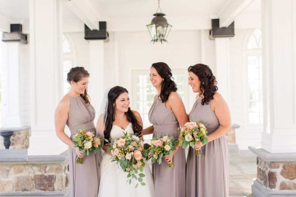 A candid, fun photo of the bride and her bridal party laughing in these Ryland Inn Wedding Photos