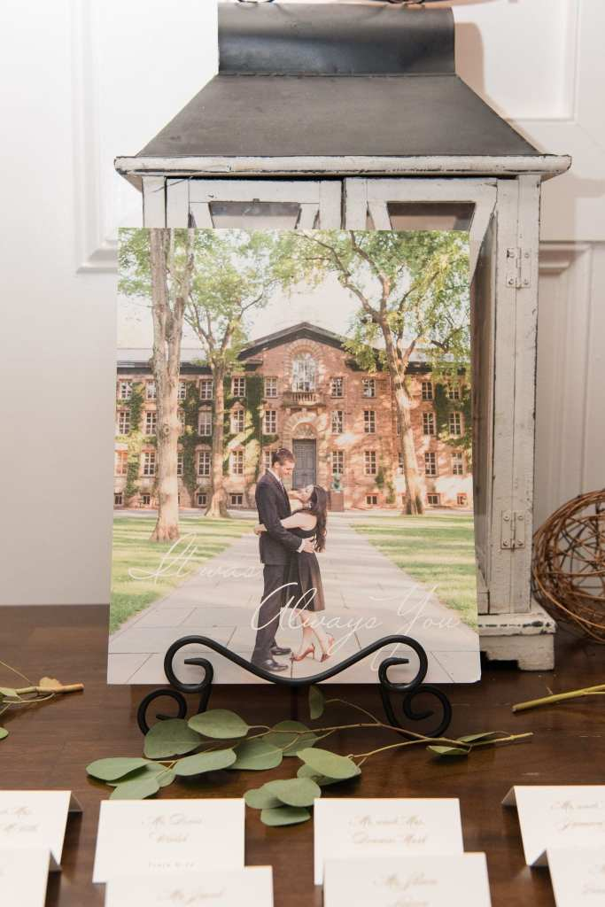 Couples engagement photo on display on escort card table