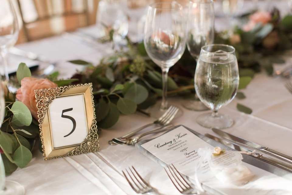 Details of floral and candle centerpieces by Bloomery Flower Studio