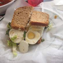 "Monie ordered the egg salad sandwich. fresh Deli has their own take on this classic sandwich, made with their fresh baked bread by the way. Instead of a giant scoop of mayonnaise with a few chopped eggs, Fresh Deli slices their local boiled eggs and serves it on local greens. Hence ""egg salad"". Well done, Nostalgia Farms!"