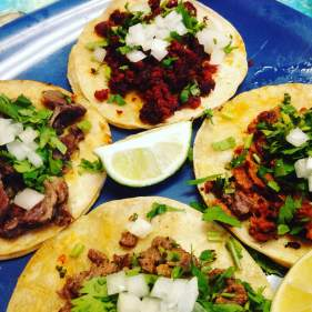 Four of my best friends! Top taco is chorizo (ground Mexican sausage), to the right is pork pastor, bottom is carne asada (tender steak), and to the left is juicy lengua. (Beef tongue)