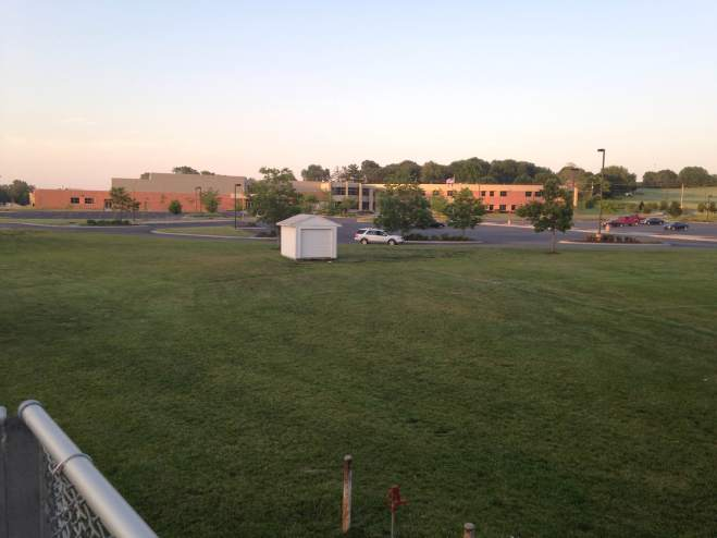 Acres of open fields surround the high school and the impending tent city coming in July.