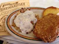 Iowa's one and only Breaded Pork Tenderloin with a side of Hashbrowns topped with Sausage Gravy!