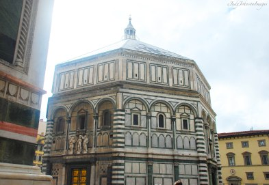 "I've always called this building ""the Baptistry"". There's a museum inside that tells about the cathedral's building period, complete with original architectural models. The doors on the ""Baptistry"" are amazing. They are made of bronze and depict stories from the Bible."