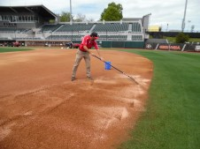 Scout Carter of Blackshear, GA rakes the clay into the infield around 1:30 pm. The purpose is to replace cracks in the infield dirt. (April 15th) Photo Credit: Jaylon Thompson, Multiplatform news