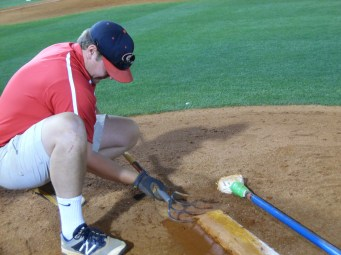 """Chris Conley, a senior, edges the dirt on the pitching rubber. He will then """"stamp"""" it into place. (April 15th) Photo Credit: Jaylon Thompson, Multiplatform news"""