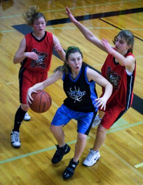 A 7th-grade girl eyes the net during a middle school basketball tournament in Missoula, Mont.