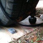 Ant traps & moth balls near tire