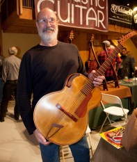 Ken Parker with his latest Creation, a 3.5 pound Wood and Carbon Archtop. Photo © Jay Rosenblatt