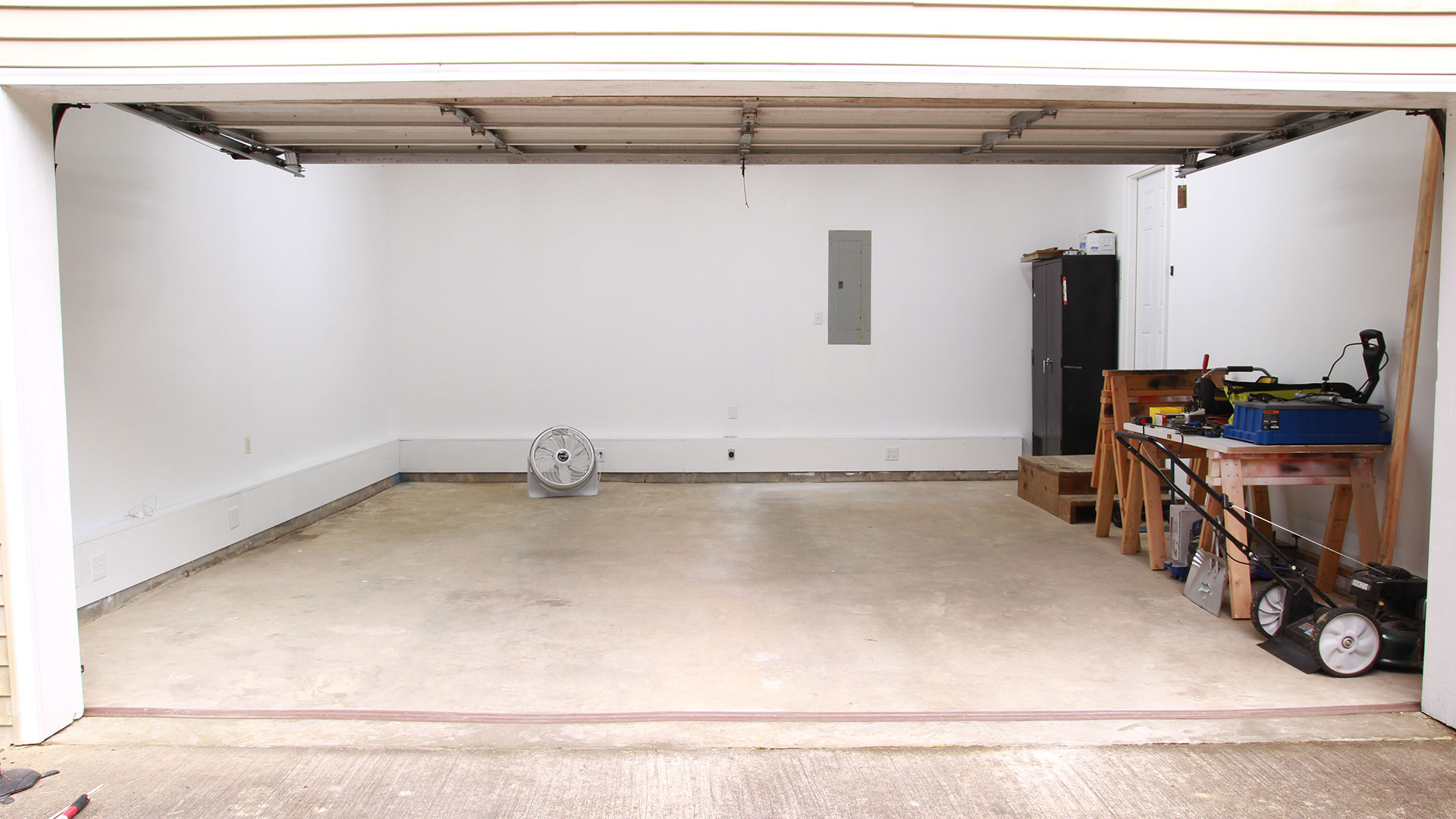 hight resolution of  i gave the walls a fresh coat of white paint and ran new electrical wires for the shop inside a long box along the bottom of the left and rear walls