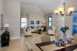 Sand Dollar Model Living Room Dining Room at ChampionsGate