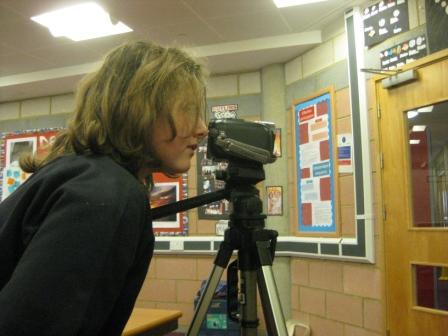 Laura Sets Up Camera Shot