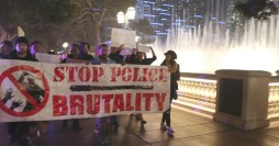 Marching to the die-in at Bellagio. Photo by Beverly Yuen Thompson