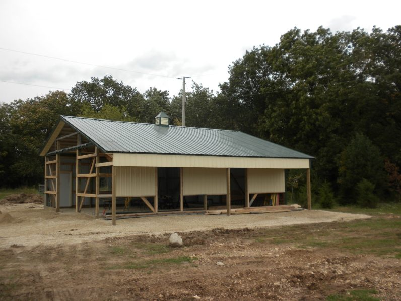 shed under construction with metal roof