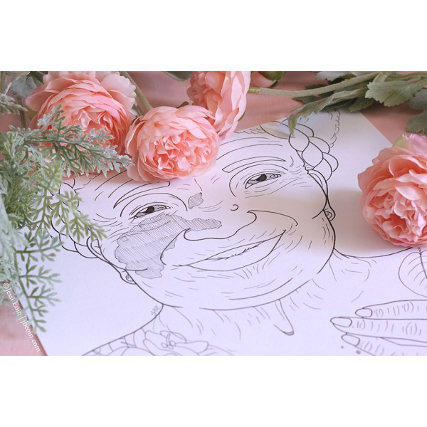 A photo of a piece by Jessi Eoin; the art is an inked illustration showing a cis elderly woman with lots of wrinkles smiling sweetly at the audience. She has a large facial birthmark on the left cheek that spreads slightly onto her nose and a smaller birthmark on the bridge of her nose next to the left eye, along with a mole on the right side of her nose. She has her hair braided slightly in a crown style with the rest left as an afro. Her hand is visible on her chest, along with a glimpse of a tattoo on the left shoulder. The photo is stylized with a pink background and with some ranunculus and a dusty miller plant surrounding the top of the piece.